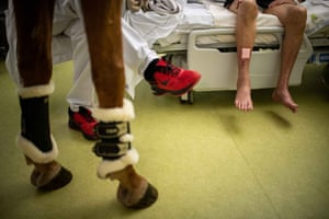 The legs of Peyo, Bouchakour and Robert, the patient they are visiting at Calais Hospital
