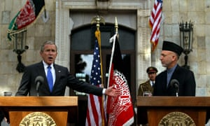 Presidents George W. Bush and Hamid Karzai at a press conference in Kabul on 1 March 2006.