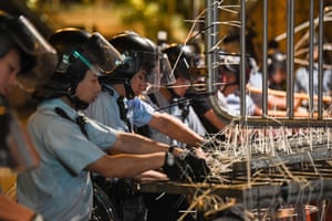 Hong KongPolice clear barricades which were set up by protesters outside the police headquarters in Hong Kong