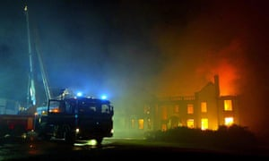 Fire fighters tackling a blaze, Friday 23 January 2004 at Gleddoch House a five-star hotel and spa near Greenock in Inverclyde, Scotland.