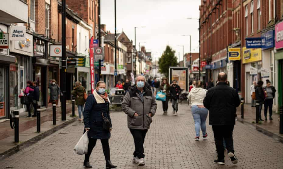 Shoppers wearing face masks on the high street in Leigh, Greater Manchester