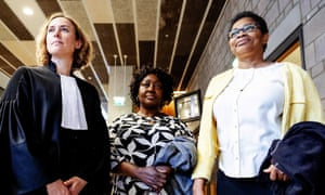 Esther Kiobel and Victoria Bera from Nigeria and their lawyer Channa Samkalden stand in court after the verdict in the trial of the Nigerian widows against Shell in The Hague.