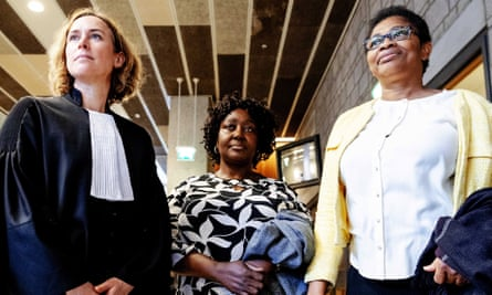 Esther Kiobel, right, and Victoria Bera, centre, whose husbands were among nine men killed in Nigeria in 1995, stand alongside their lawyer Channa Samkalden after the hearing in The Hague