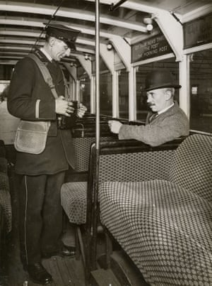 A passenger buys a ticket from a conductor, 1929