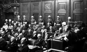A general view in the Palace of Justice, Nuernberg, as defendants heard parts of the verdict read by the International Military Tribunal, Sep. 30, 1946. Hans Frank is in the front row, fourth from right.