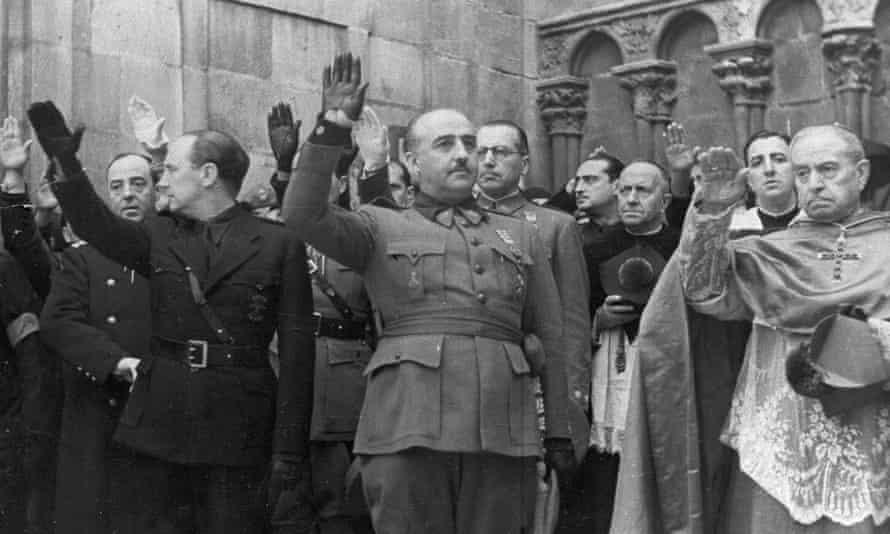 Francisco Franco gives a salute