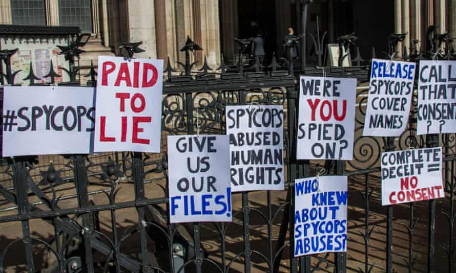 Signs by protesters at the Royal Courts of Justice in 2019.