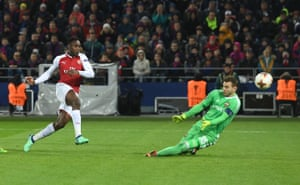 Welbeck shoots past Akinfeev to score for Arsenal.