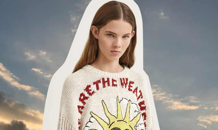 Model wears jumper with 'We are the weather' emblazoned on it.