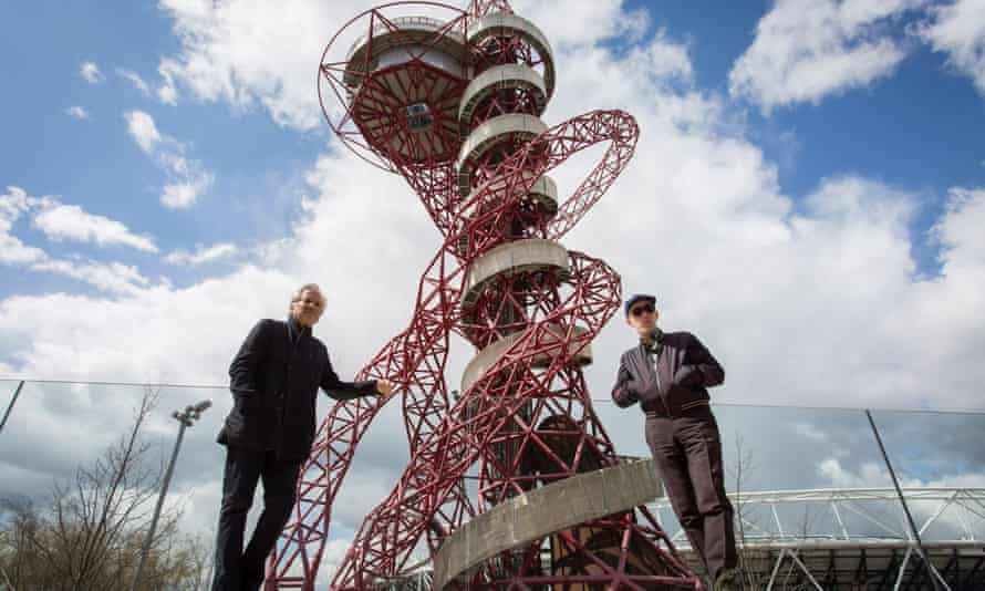Anish Kapoor (left) and Carsten Höller pose in front of the ArcelorMittal Orbit tower