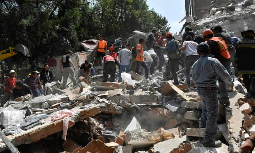 People remove debris from a collapsed building in Mexico City.