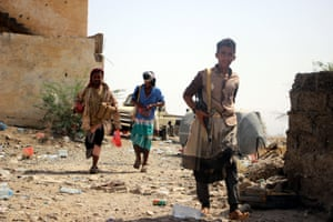 Members of Yemeni pro-government forces patrol at a position during a fragile ceasefire in the port city of Hodeidah, Yemen, 26 January 2019.