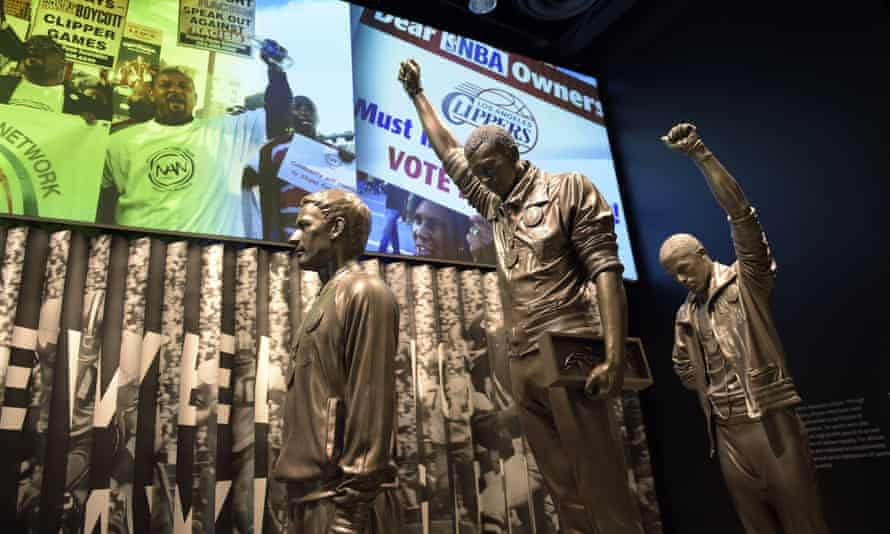 A statue of the 1968 Olympics black power salute is on display at the National Museum of African American History and Culture in Washington.