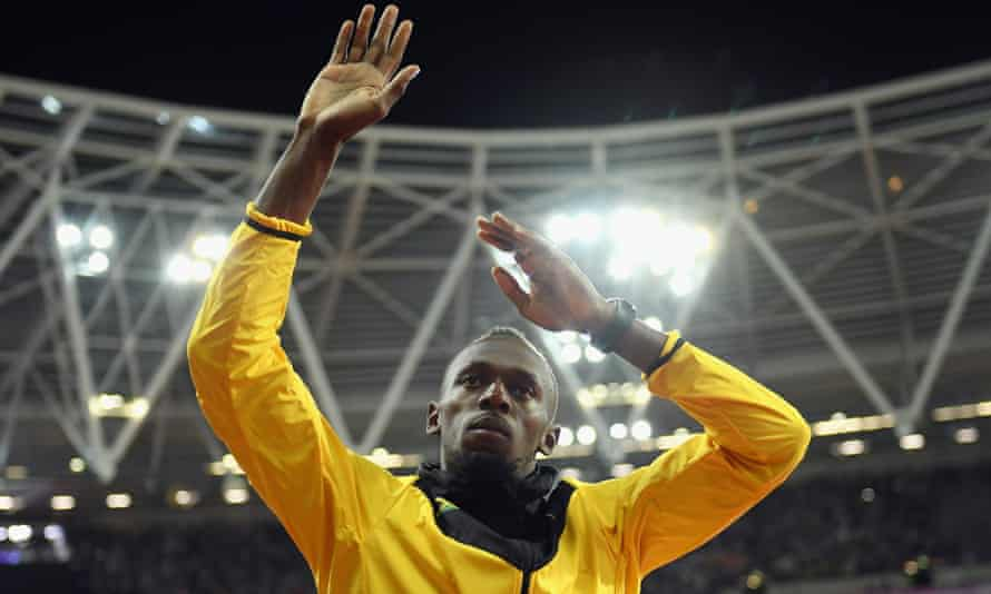Usain Bolt waves farewell to  the crowd on the final night of the world championships at the London Stadium