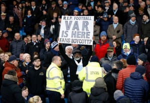 A fan holds a boycott VAR sign in the stands at the Etihad.