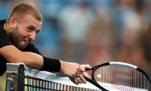 An exhausted Dan Evans takes a breather during his win against Alex de Minaur at the ATP Cup.