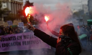 A woman burns a flare in Madrid.