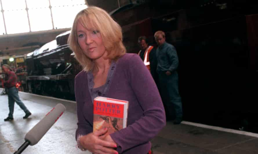 JK Rowling holds a first edition of Harry Potter and the Goblet of Fire at King's Cross station in 2000.