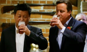 David Cameron and Chinese president Xi Jinping drink a pint of beer