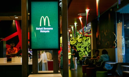 A McDonald's logo is seen inside one of the company's restaurants in Shah Alam outside Kuala Lumpur, the Malaysian capital