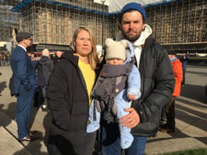 Victoria Lowe and her partner, Ryan Bennett, with their 11-month-old baby at  protest in London