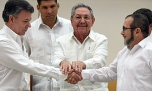 President Raúl Castro blesses a provisional agreement between President Juan Manuel Santos, left, and the Farc leader, known as Timochenko on 23 September 2015.
