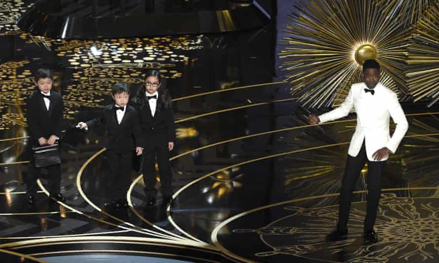 'Tasteless and offensive' ... host Chris Rock's skit about east Asian child accountants was described as 'tone deaf' in an open letter by 24 members of the Academy.