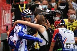 A dejected Thibaut Pinot is consoled after the stage.