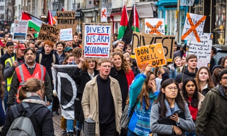 Students march through Cambridge in November 2018 urging the university divest from fossil fuels and arms.