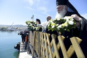 Pope Francis throws wreaths with Patriarch Bartholomew I and Archbishop Jerome in the port of Mytilene in memory of migrants who died at sea trying to reach Europe