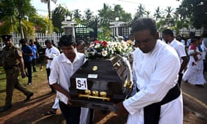 Priests and relatives carry the coffin of a bomb blast victim after a funeral service at St Sebastian's Church in Negombo.