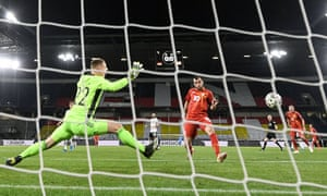 North Macedonia's Goran Pandev scores the opening goal of the game.