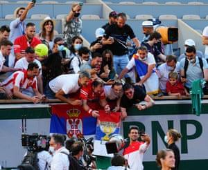 Novak Djokovic celebrates with a selfie with his fans .