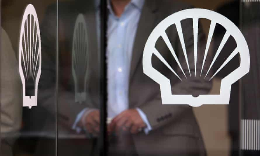 A person leaves Shell's London office