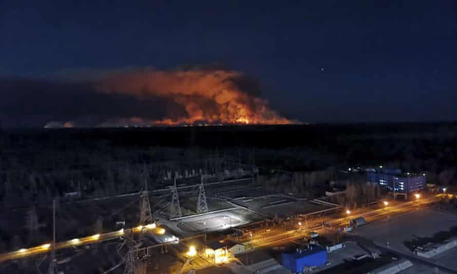 Wildfire at night in distance
