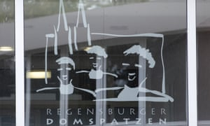 The logo of the Regensburger Domspatzen choir on a window at the school in Regensburg, Bavaria