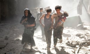 A fleeing woman and youths, one of them carrying a baby, Aleppo, 2014