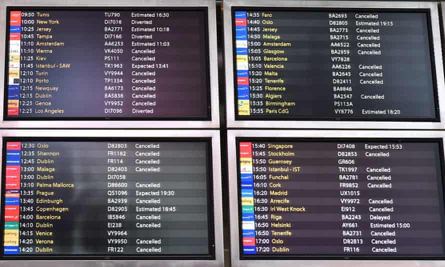 An information board shows scheduled flights arrivals cancelled and diverted at Gatwick airport.