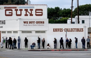 People wait in a line to enter a gun store in Culver City, California.