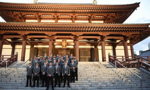 New Zealand's Rugby World Cup line up on the steps of the Zojoji temple