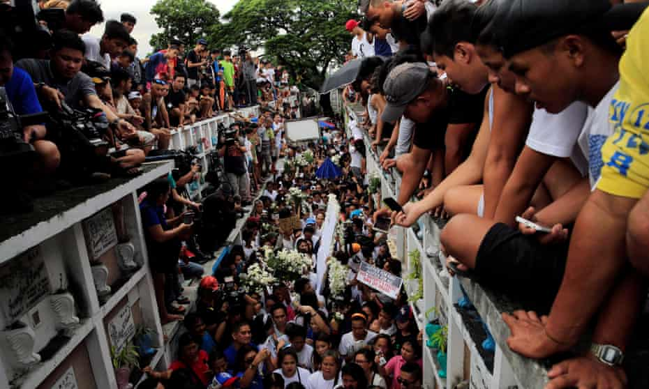 Mourners watch as Kian Delos Santos, a 17-year-old student shot during anti-drug operations, is buried in Caloocan, on the outskirts of Manila, August 2017.