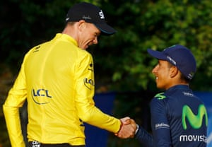 Yellow jersey Froome shakes hands with Quintana on the Champs-Elysees in Paris.