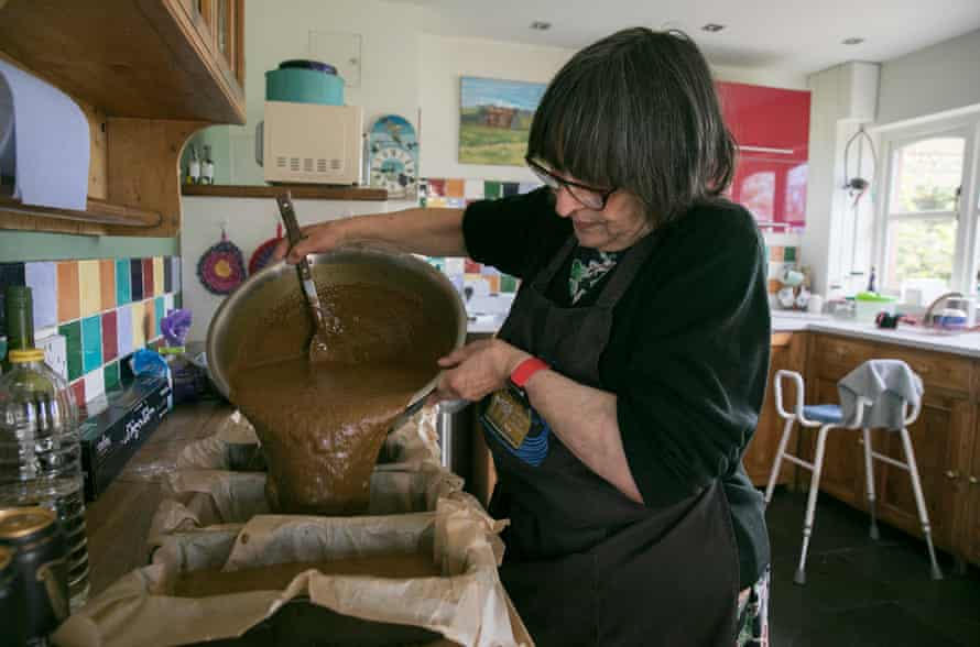 Williams' mother, Athena, bakes laver ginger cake in her kitchen for his beach cafe.