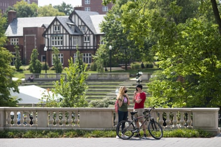 Students wearing protective masks talk on campus on the first day of classes at Ohio State University in Columbus, on 25 August.
