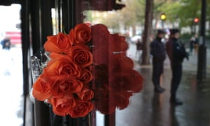 Flowers laid at the Bataclan Cafe after a ceremony marking the first anniversary of the Paris attacks