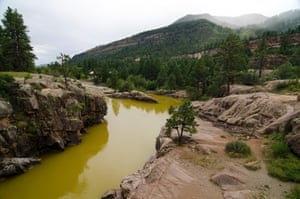 The water is stained a mustard yellow near Baker's bridge north of Durango