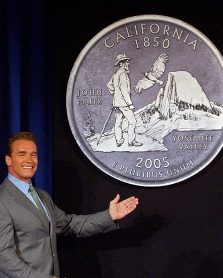 Then-California Governor Arnold Schwarzenegger displays the final choice for the California commemorative quarter, featuring an image of naturalist John Muir.