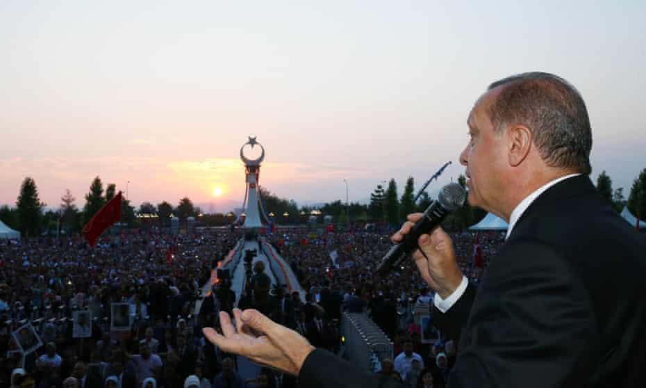 Recep Tayyip Erdoğan speaks to marchers at the Bosphorus bridge, which has been renamed the July 15 Martyrs bridge.
