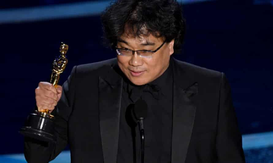 Bong Joon-ho with his best director award at the 92nd Academy Awards.