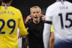 The eyes have it: referee Martin Atkinson has a word with Álvaro Morata of Chelsea and Eric Dier of Tottenham Hotspur at Wembley
